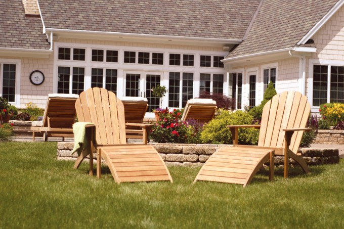 Double Unique Teak Adirondack Chairs On Green Grass For Patio Decor Ideas