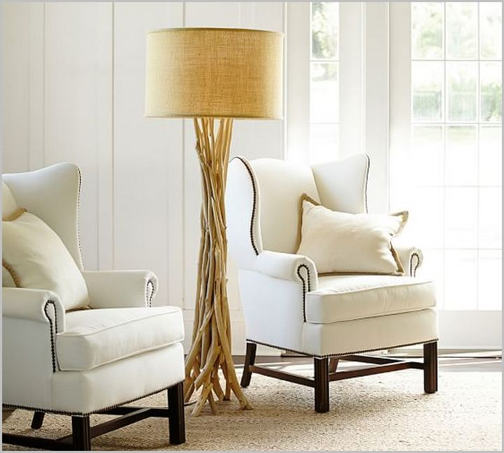 driftwood floor lamp in cream plus white sofa on wheat carpet for living room decor ideas
