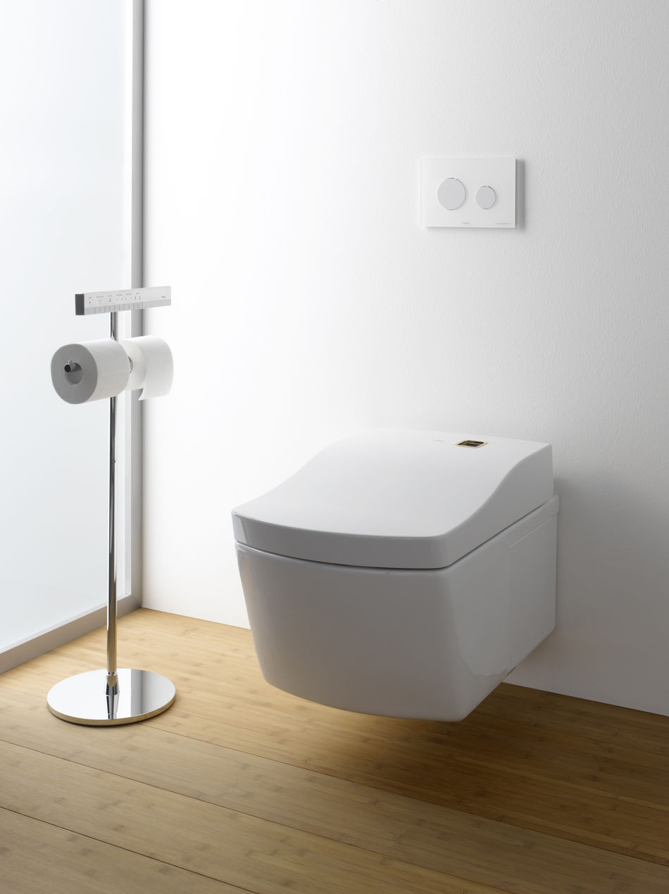 Electronic toto toilets on white wall matched with wooden floor plus rolled tissue for bathroom ideas