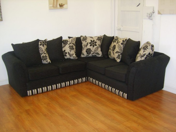 Elegant Cheap Sectional Sofas In Black Plus Cushions On Wooden Floor Matched With White Wall For Living Room Decor Ideas