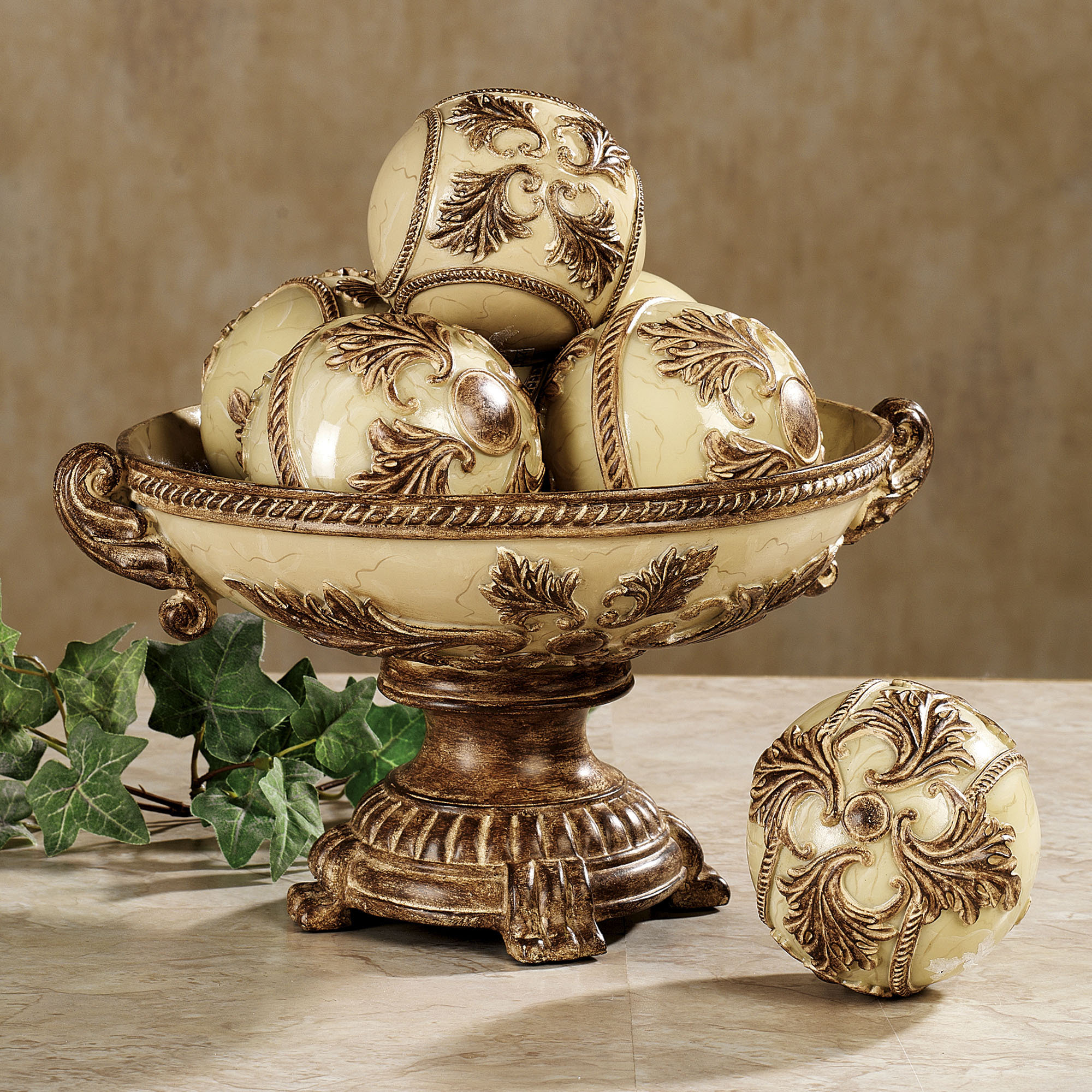 elegant decorative orbs in golden with floral ornament for table accessories ideas