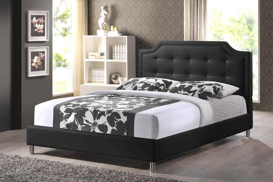 elegant upholstered headboards in black matched with chic bedding and pillows on wooden floor before the tan floral wall paper for bedroom decor ideas