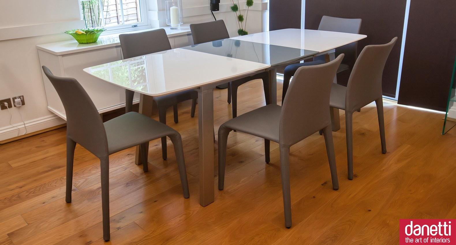 expandable dining table set in grey with rectangular table and chairs on wooden floor for dining room inspiration