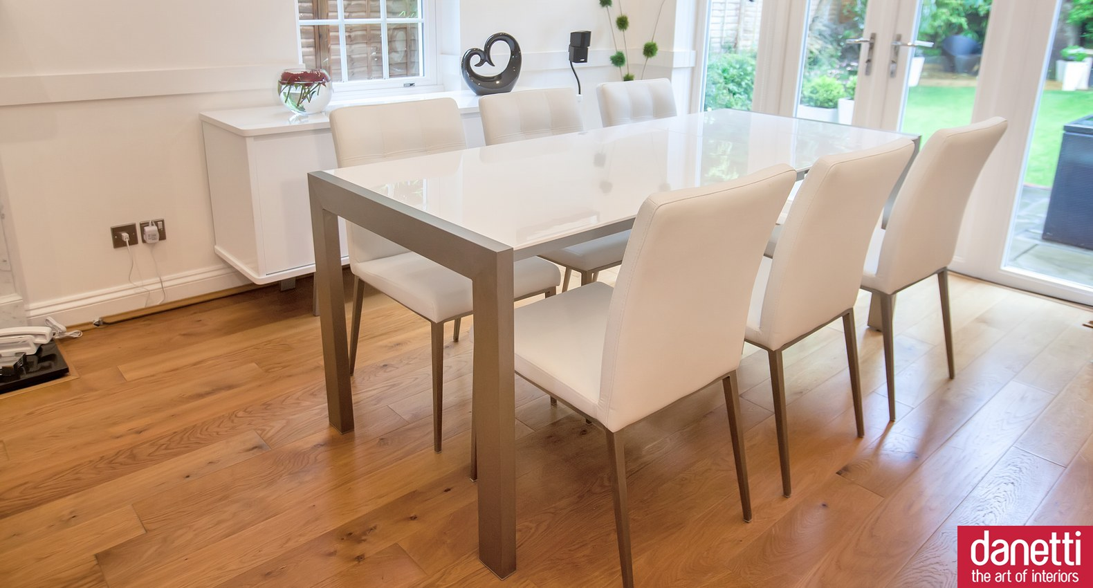 expandable dining table set in white on wooden floor for dining room decor ideas
