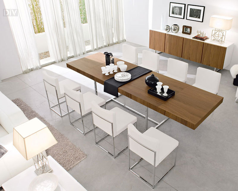 expandable dining table set with wooden table and white chairs on grey floor for inspiring dining room decor ideas