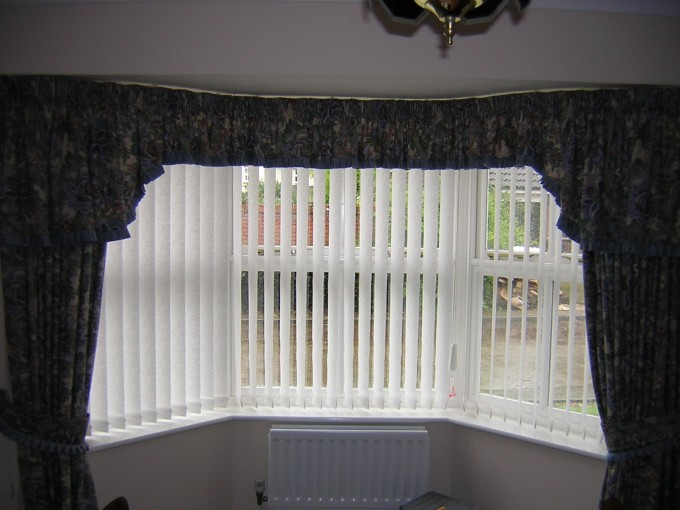 Glass Window With Bali Blinds And Floral Curtains On White Wall For Home Interior Design Ideas