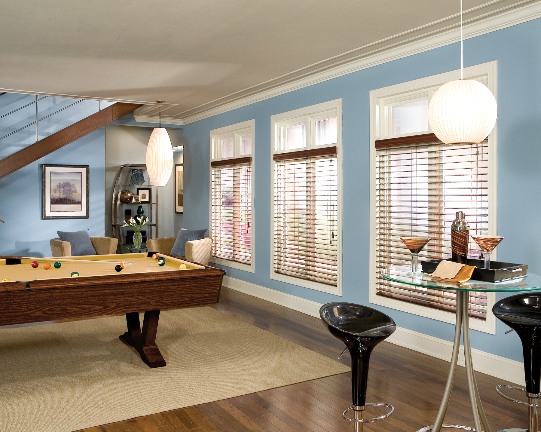 glass window with trim board window and bali blinds on blue wall matched with wooden floor for interior design ideas