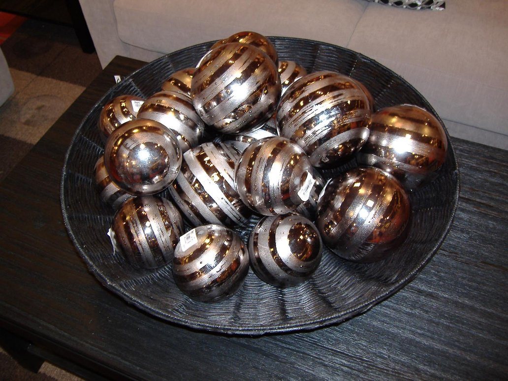 golden decorative orbs in black bowl for table accessories ideas