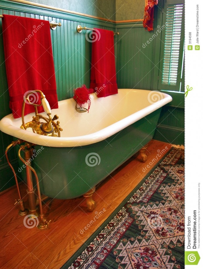 Green Bathup With White Surface And Brown Clawfoot Tub On Wooden Floor Plus Carpet And Faucet For Bathroom Decor Ideas