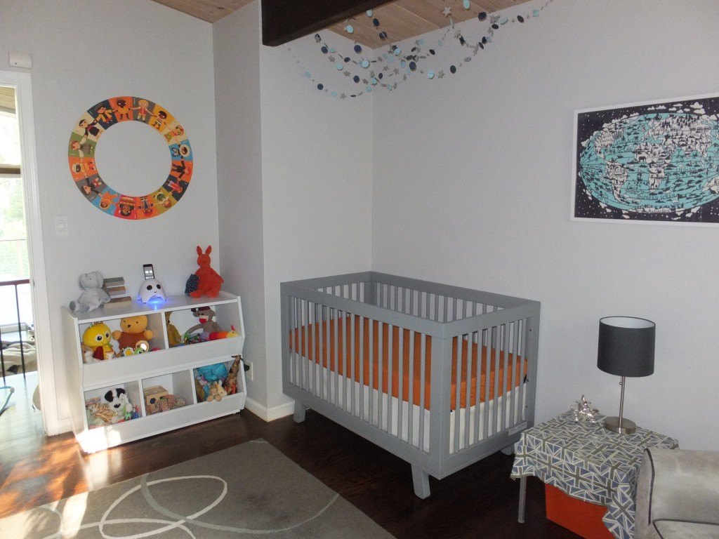 Grey Crib By Babyletto On Dark Brown Wooden Floor Plus Grey Carpet Matched With White Wall Plus Dolls Rack For Nursery Decor Ideas