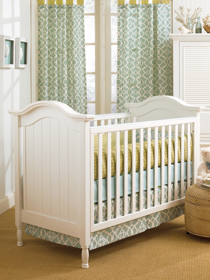 Harming White Munire Crib On Sandy Brown Carpet Matched With White Wall With White Window With Floral Green Curtain For Nursery Decor Ideas