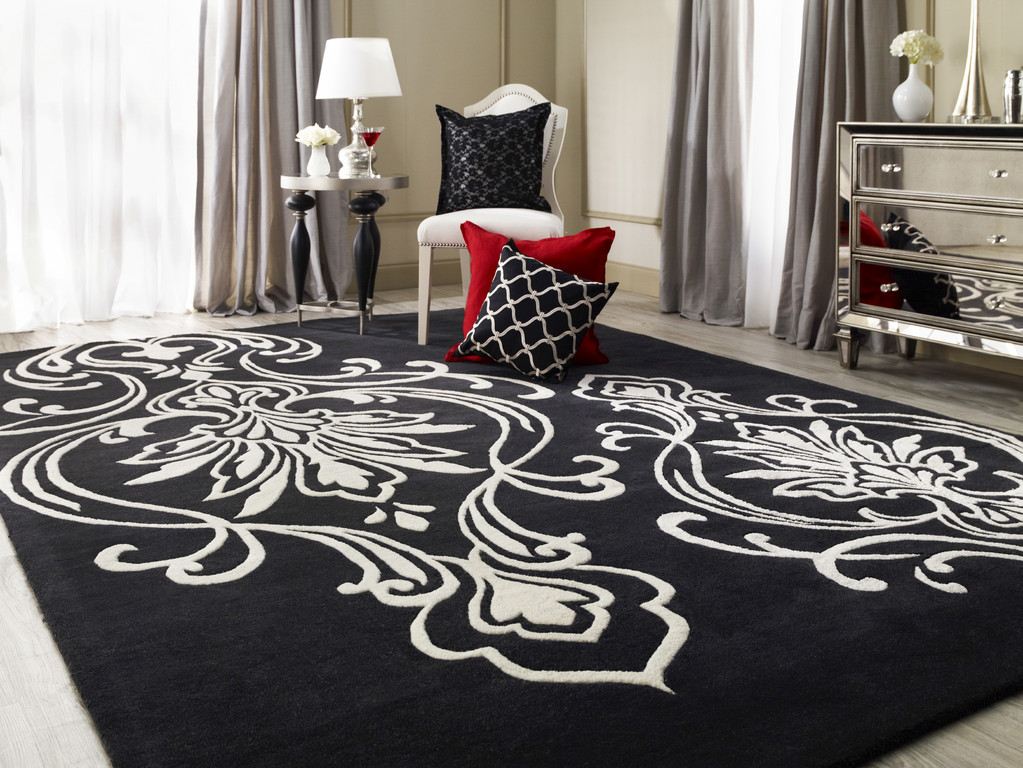 High Quality Surya Rugs In Black With Floral Motif Plus Single Sofa And Table With Table Standing For Living Room Decor Ideas