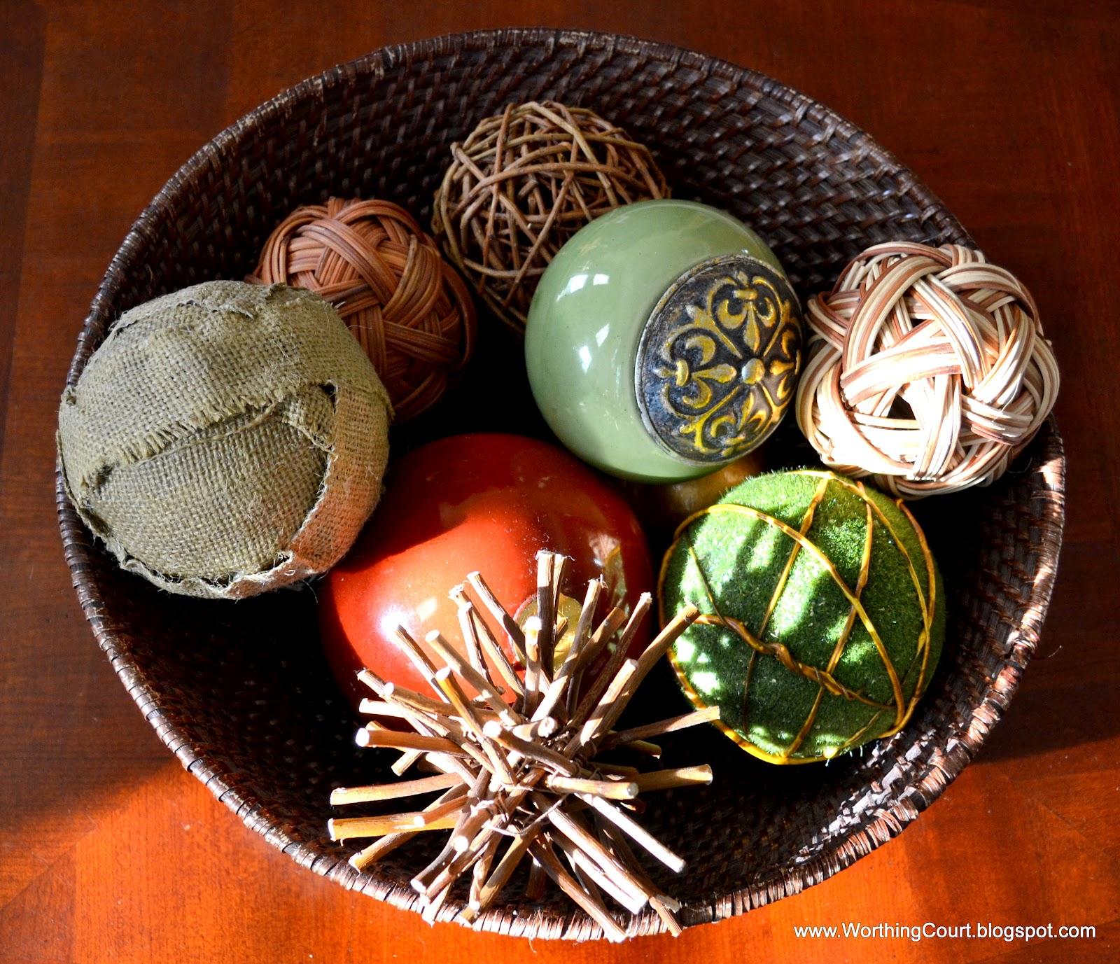 Inexpensive Decorative Orbs with many design on brown vessel for table accessories ideas