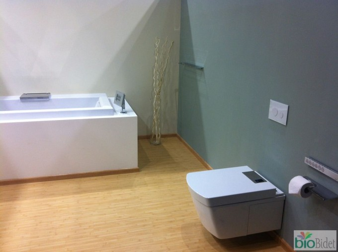 Inspiring Bathroom Design With Toto Toilets Patched On Dark Slate Grey Wall Matched With Wooden Floor Plus Bath Up Ideas