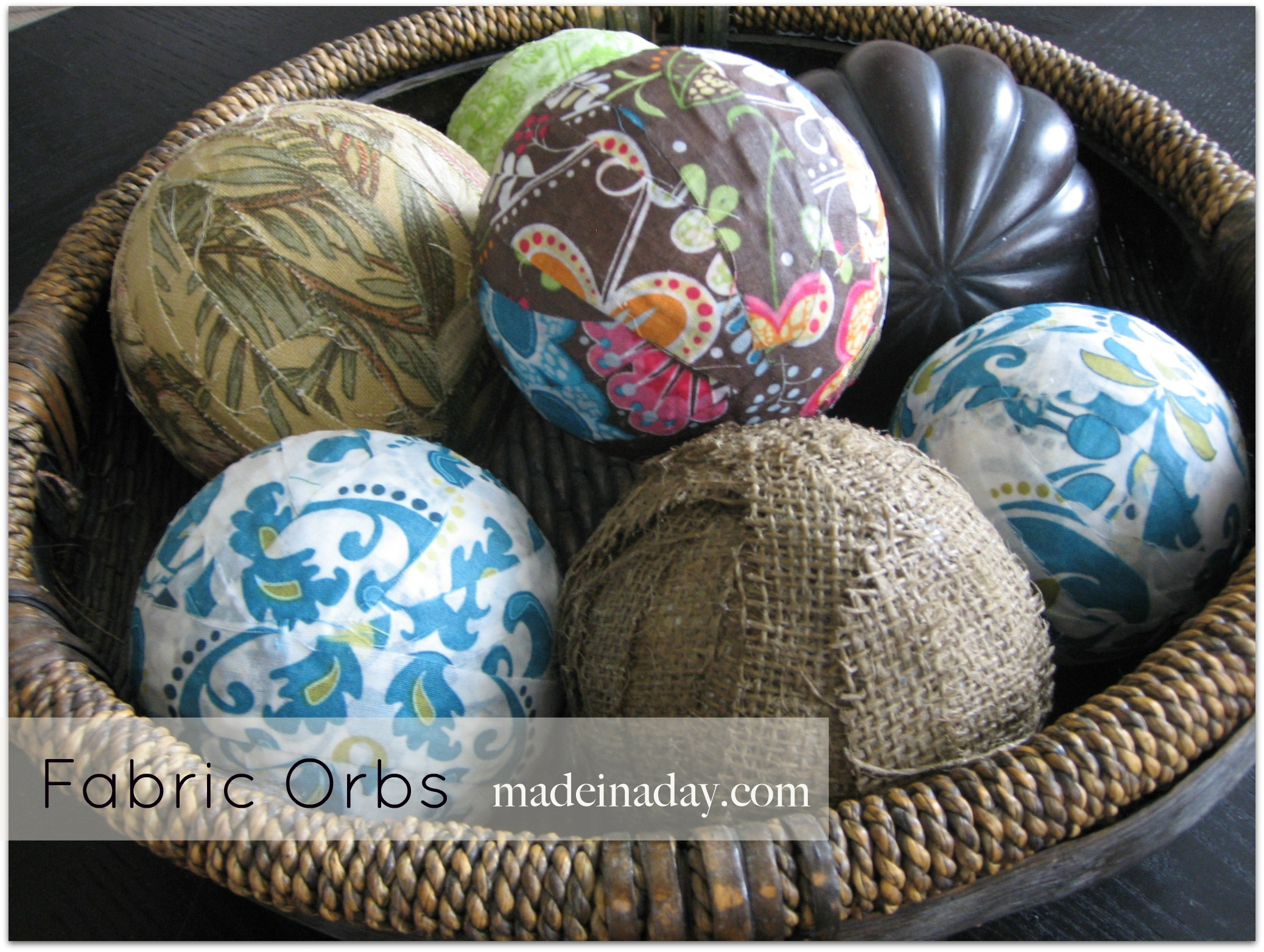 inspiring decorative orbs with floral patter and rattan vessel for charming table accessories ideas