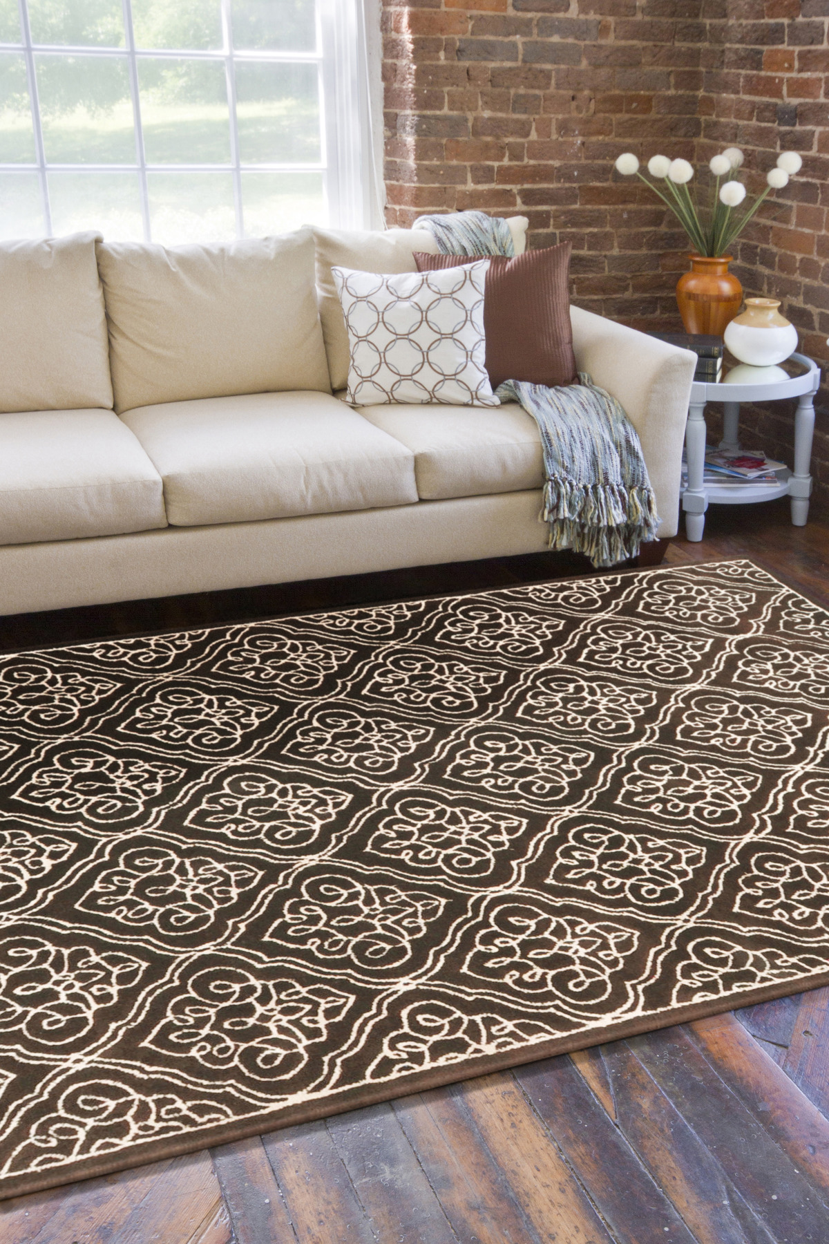 Inspiring Living Room Decor With Dark Brown Surya Rugs With Floral Pattern On Wooden Floor Plus White Sofa Ideas