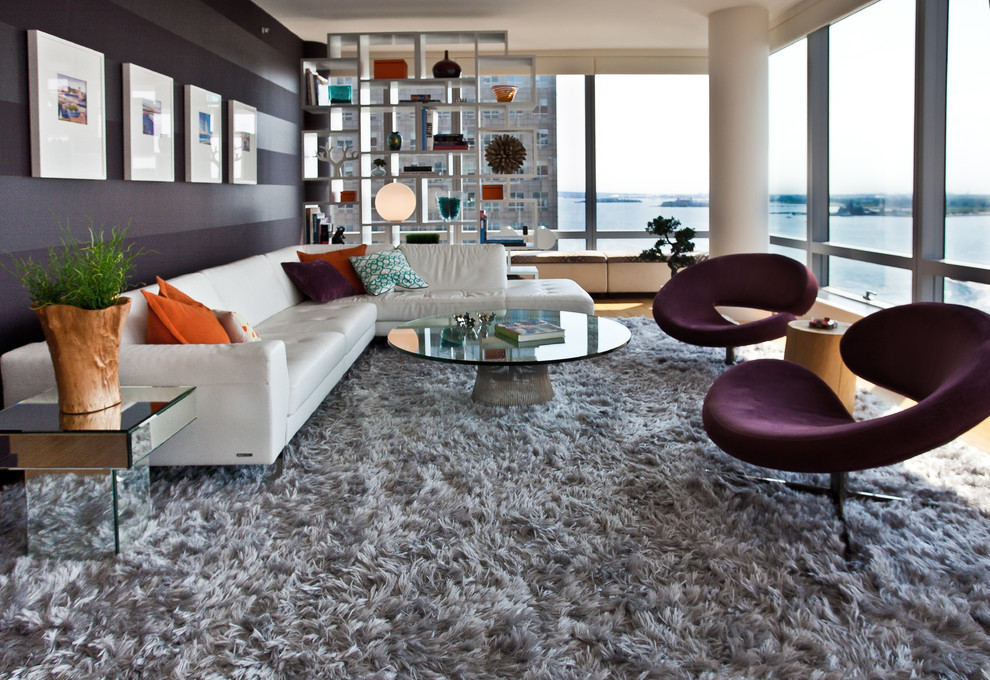 inspiring living room decoration with grey shag rugs on wooden floor plus white sofa and round glass table ideas