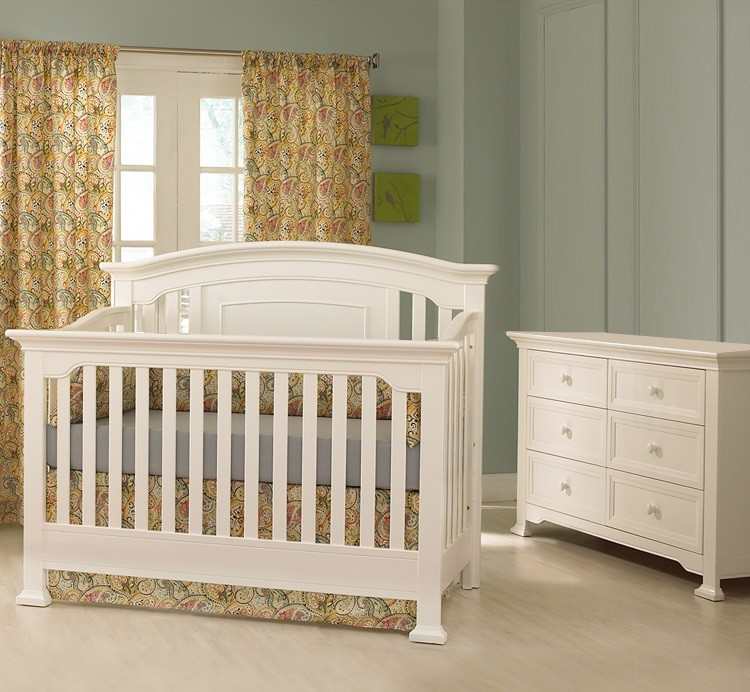 inspiring nursery decor ideas with munire crib on wooden floor matched with blue wall with yellow floral curtain