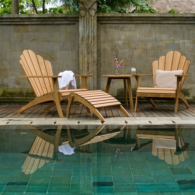 Inspiring Patio Decor With Teak Adirondack Chairs And Wooden Table Near The Swimming Pool Ideas