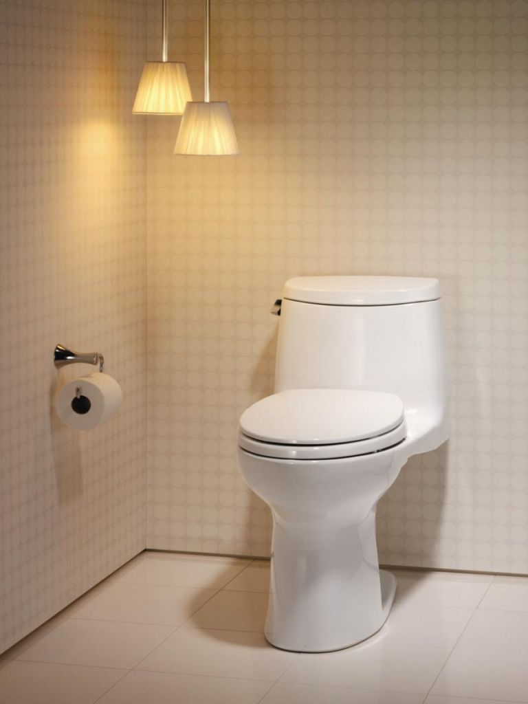 inspiring toilet design with toto toilets in white ceramics floor matched with white wallpaper wall ideas