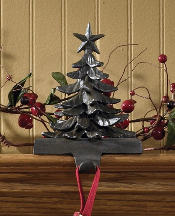 iron christmas stocking hanger in black and christmas tree design for christmas decoration ideas