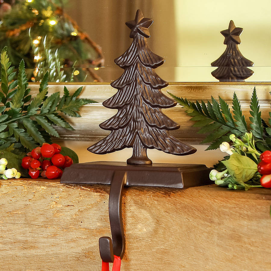 iron christmas stocking hanger with christmas tree design for christmas decoration ideas