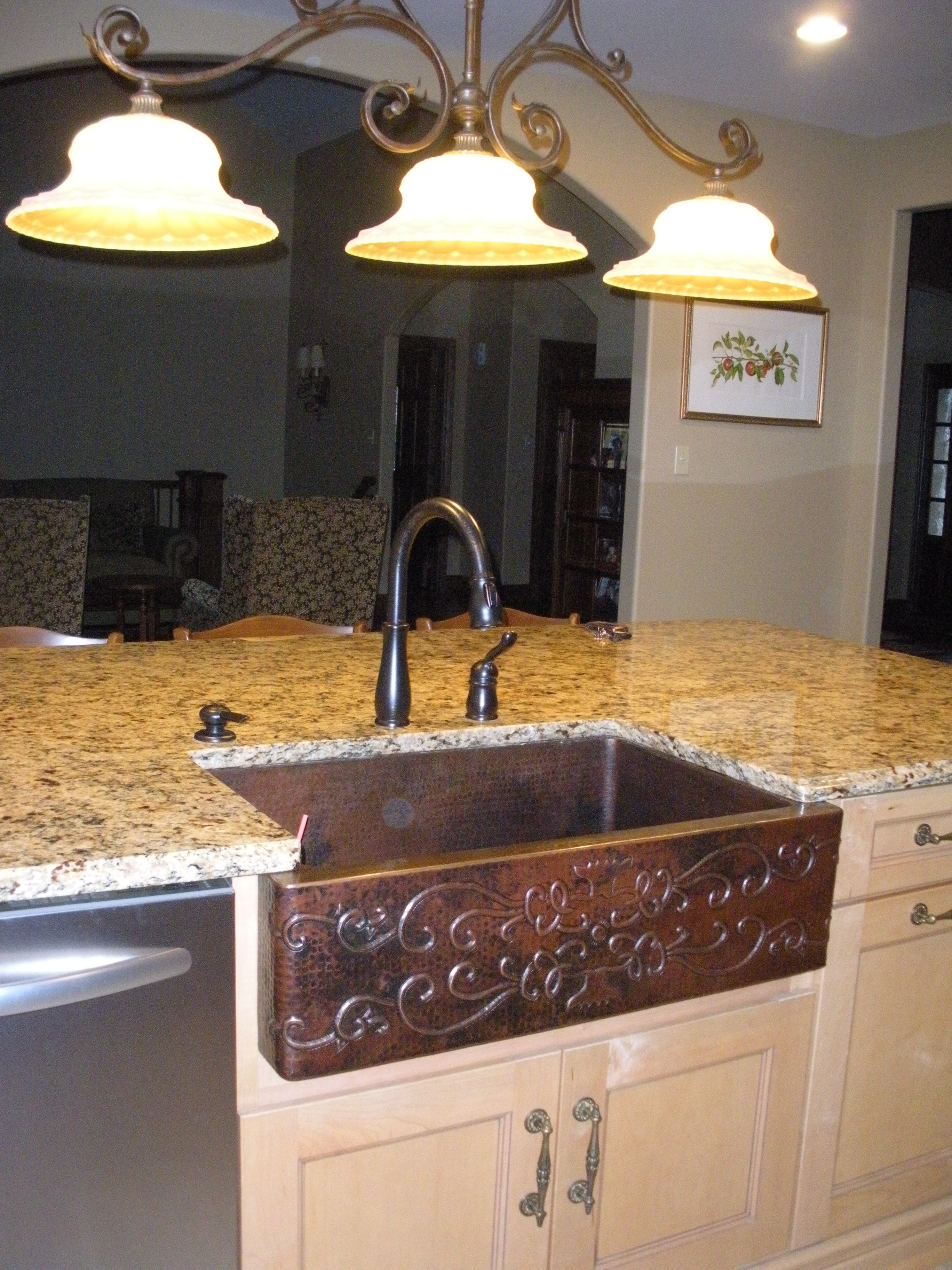 kitchen island decor with brown apron sink on white kitchen cabinet with countertop and faucet plus chandelier ideas