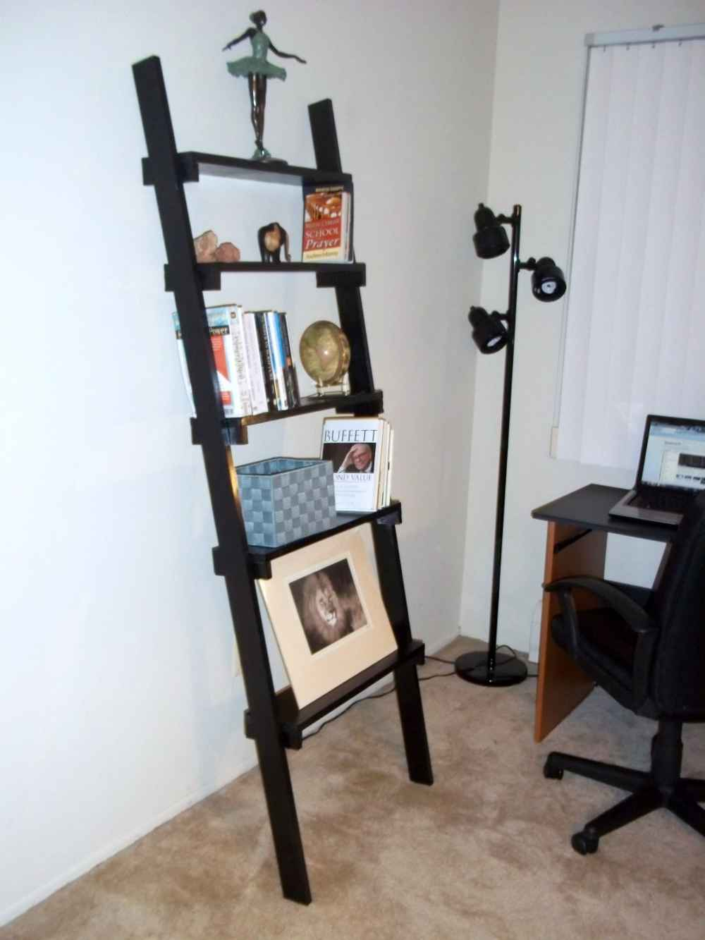 ladder bookshelf in black on brown tile floor matched with white wall plus desk and black chair for home office decor ideas