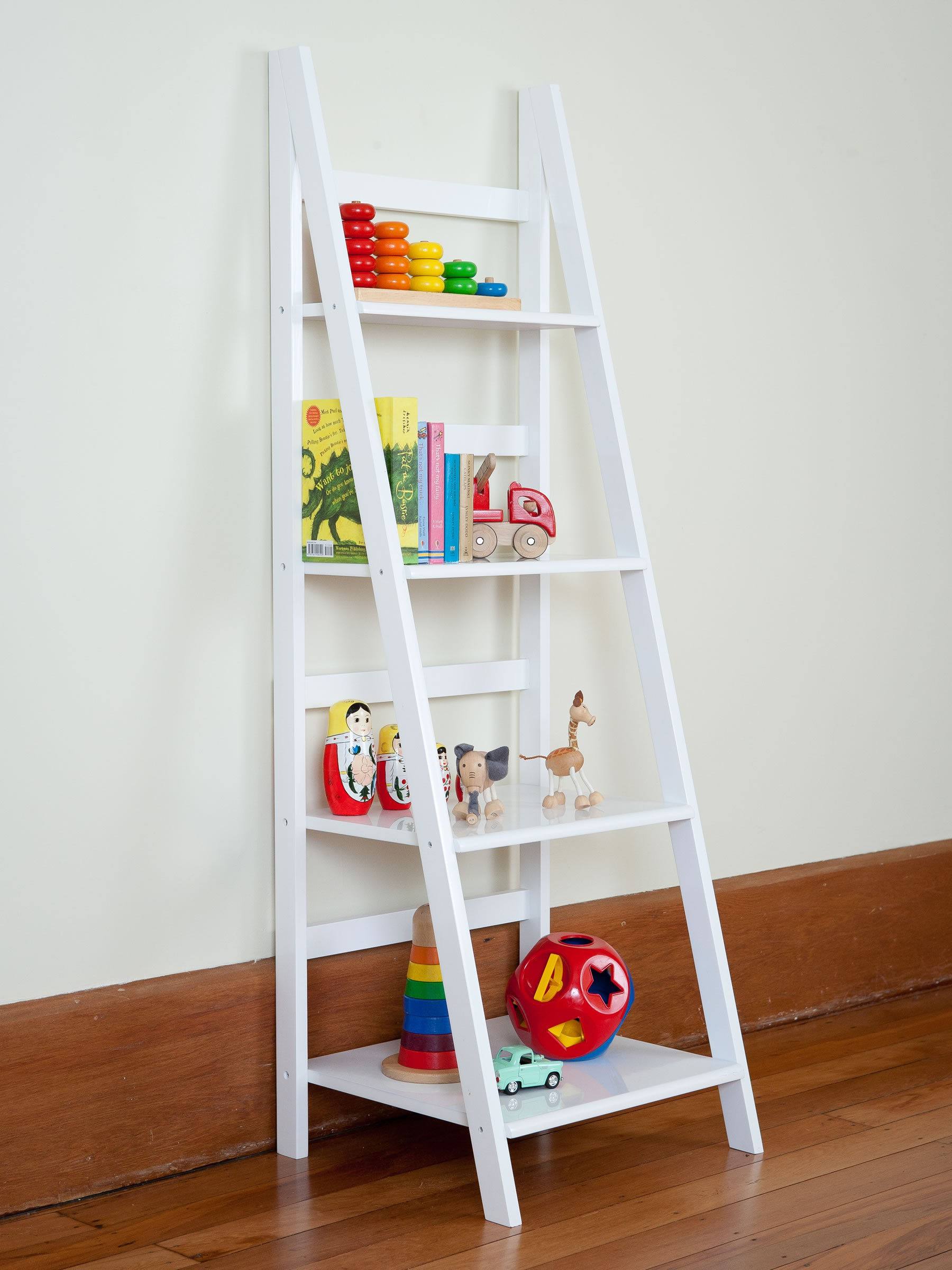 ladder bookshelf in white on wooden floor matched with white wall for interior decor ideas