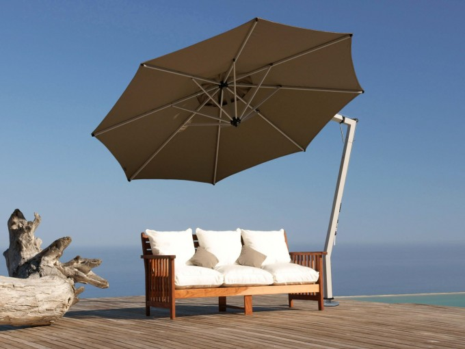 Large Cantilever Patio Umbrella In Tan With White Stand Plus Single Wooden Sofa With White Seat For Patio Decor Ideas
