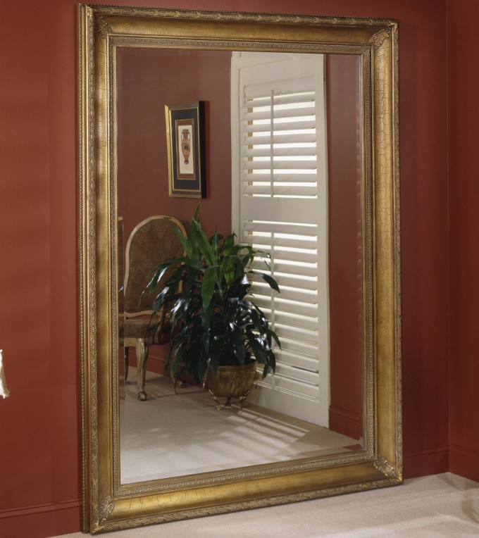 Large Leaner Mirror With Golden Frame On Orange Wall For Home Decor Ideas