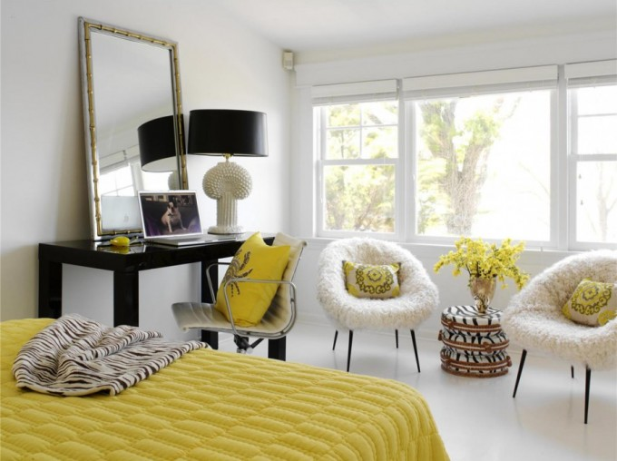 Leaner Mirror On Black Wooden Table Plus Yellow Bedding And Comfortable White Chairs For Inspiring Bedroom Decor Ideas