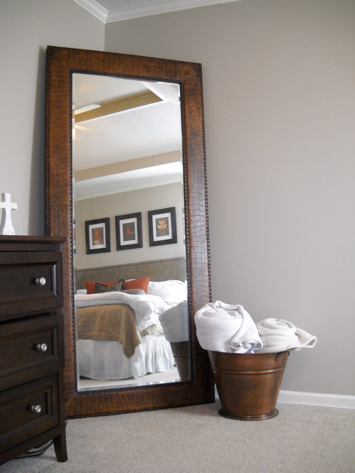 leaner mirror with brown wooden frame on wheat floor matched with wheat  wall plus wooden dresser. Bedroom  Decorative Leaner Mirror For Home Furniture Ideas
