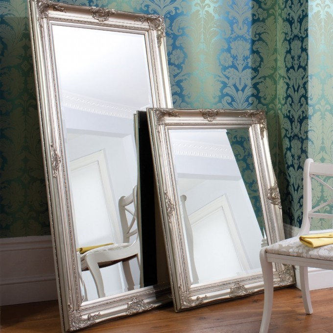Leaner Mirror With Charming Frame On Wooden Floor Matched With Green Floral Wallpaper Plus White Chair For Living Room Decor Ideas