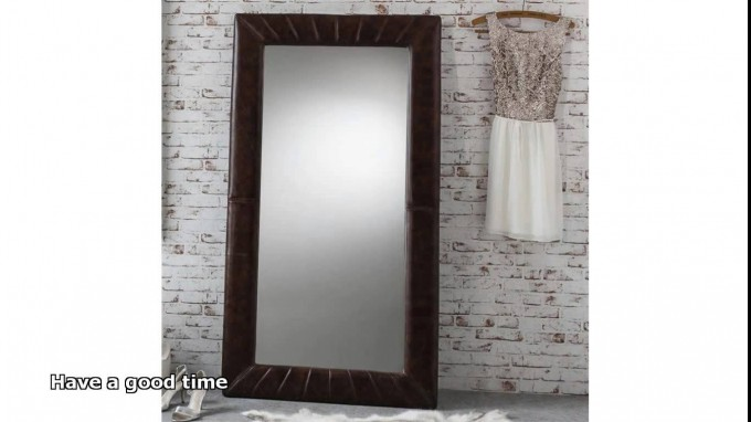 Leaner Mirror With Dark Brown Frame Before The White Wall For Make Up Room Decor Ideas