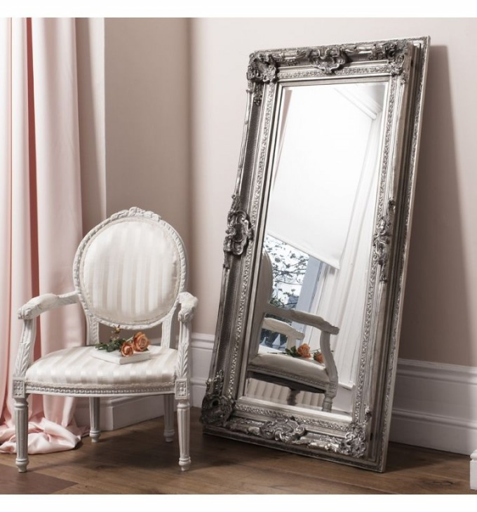 Leaner Mirror With Grey Frame On Wooden Floor Plus Chair For Living Room Decor Ideas
