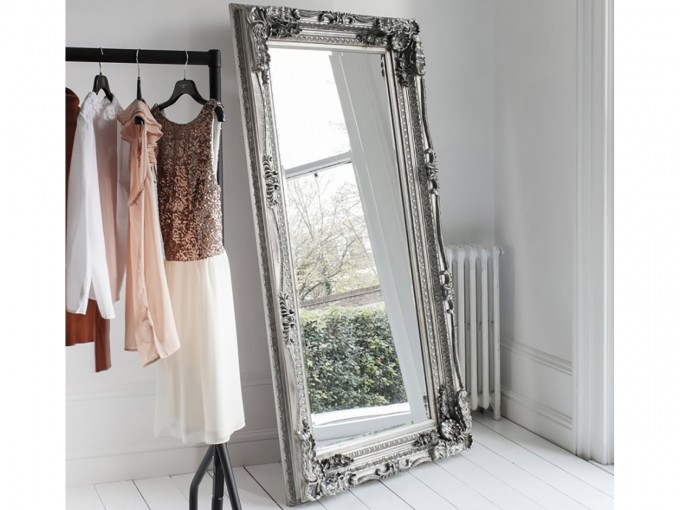 Leaner Mirror With Silver Frame On White Wooden Floor Matched With White Wall Plus Clothes Hanger For Make Up Room Decor Ideas