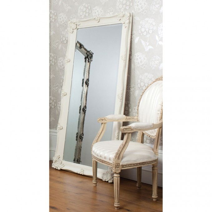 Leaner Mirror With White Frame On Wooden Floor Matched With White Wallpaper Plus Single Sofa Ideas