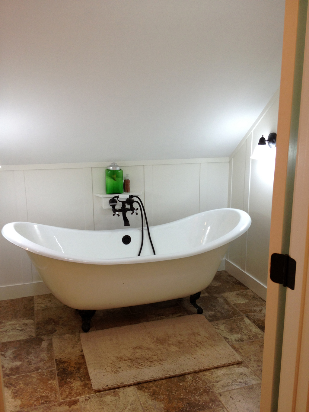 lovely bathroom unique oval clawfoot tub with black shower faucet on tan floor matched with white
