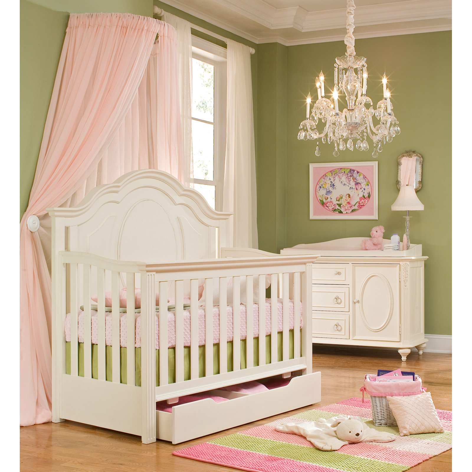 Lovely White Wooden Munire Crib With Storage On Wooden Floor Plus Lovely Stripped Carpet Matched With Olive Green Wall Plus Soft Pink Curtain And Chandelier For Inspiring Nursery Decor Ideas