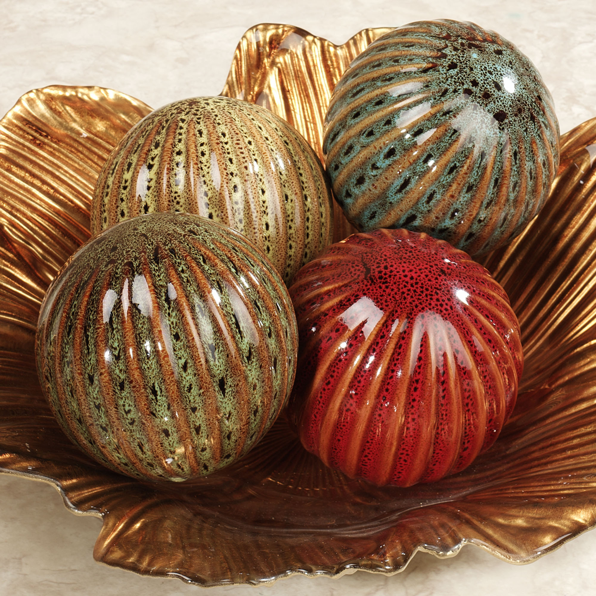 multicolor decorative orbs with golden vessel for table accessories ideas