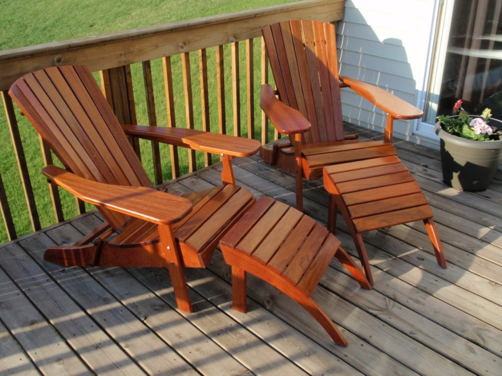 natural brown wood teak adirondack chairs on wooden deck plus wooden railing for patio decor ideas