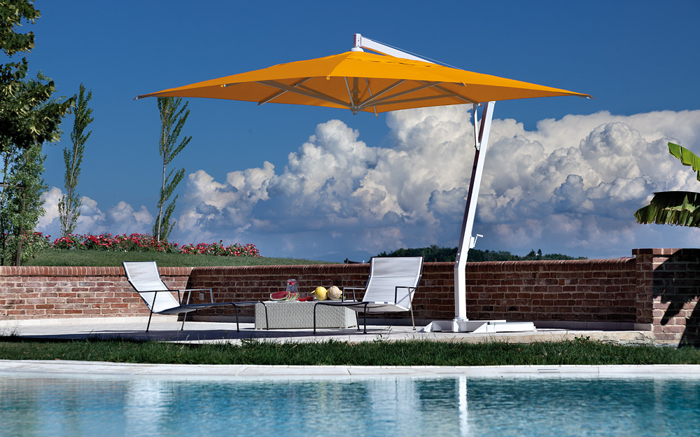 Orange Cantilever Patio Umbrella With White Stand Plus White Sofa Set Near  The Swimming Pool For