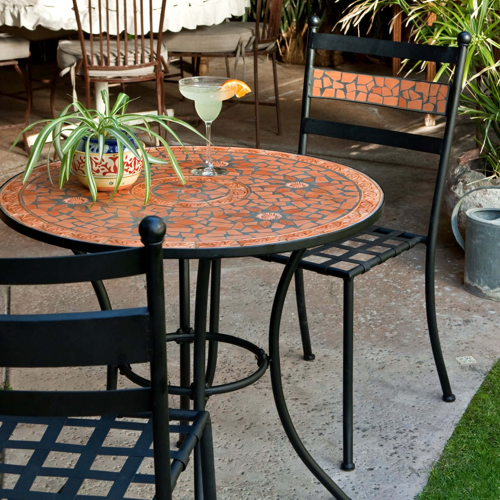 orange mosaic bistro table with black legs and chairs with mosaic back for home furniture ideas
