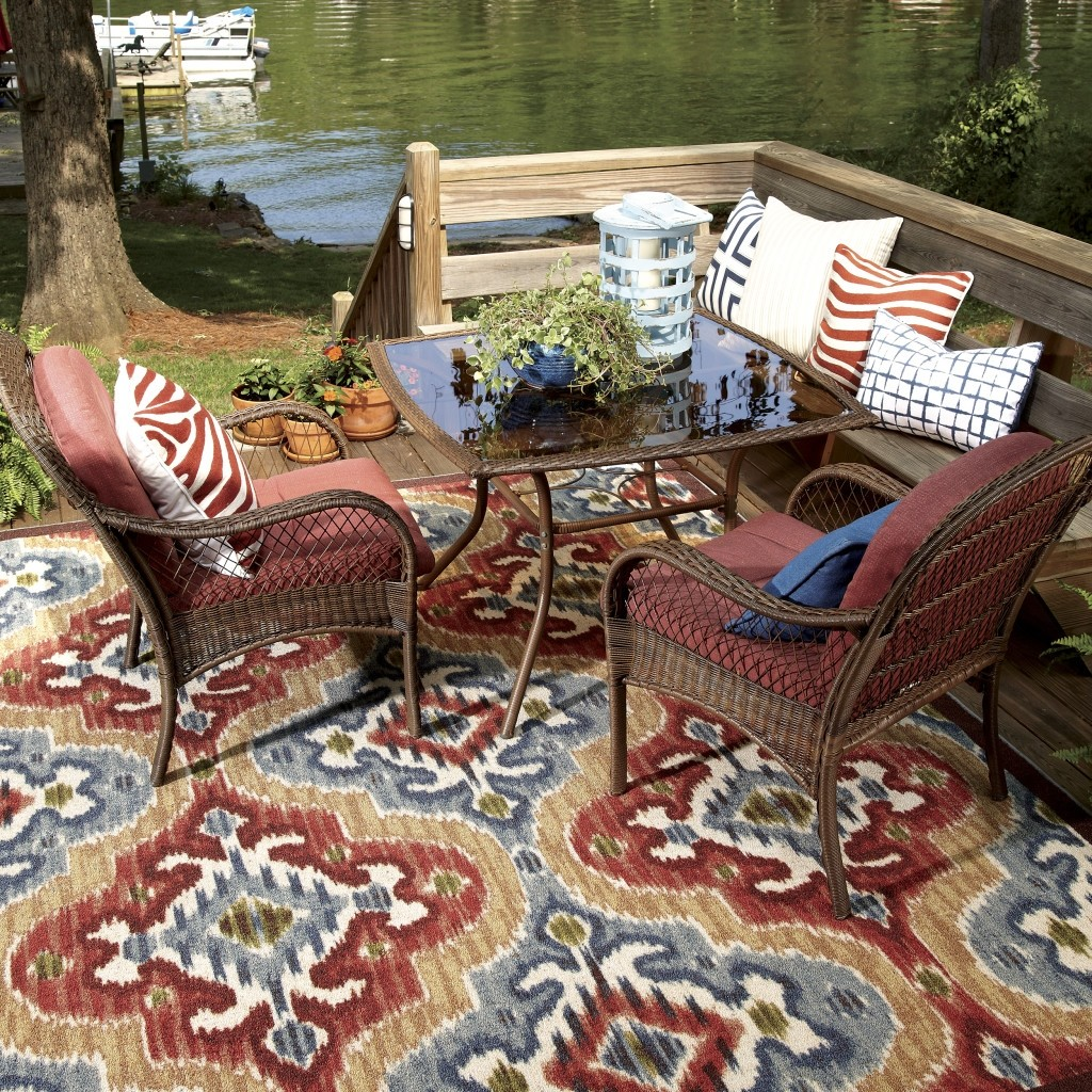 outdoor living room wirh elegant lowes rugs and sofa set plus cushion ideas