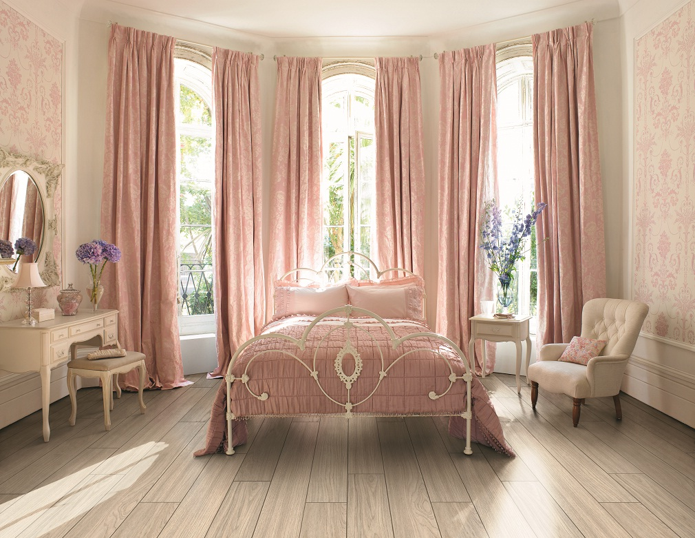 pink laura ashley bedding on wooden floor matched with cream wall plus pink curtains for lovely bedroom decor ideas