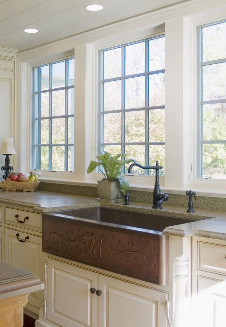 rectangle brown apron sink on antique white kitchen cabinet with black handle plus black faucet before the window for kitchen decor ideas