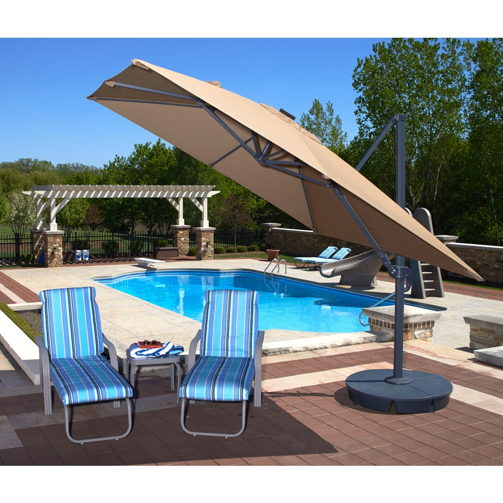 rectangle cream cantilever patio umbrella with grey stand plus blue stripped sofa near the swimming pool for patio decor ideas
