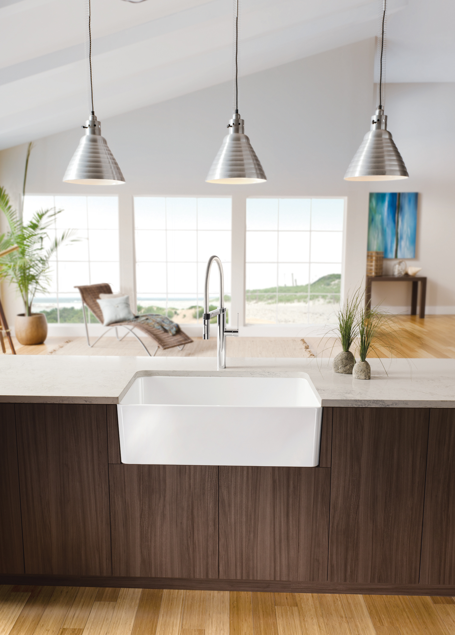 rectangle white apron sink on wooden kitchen island with white countertop plus faucet plus chandelier for kitchen decor ideas