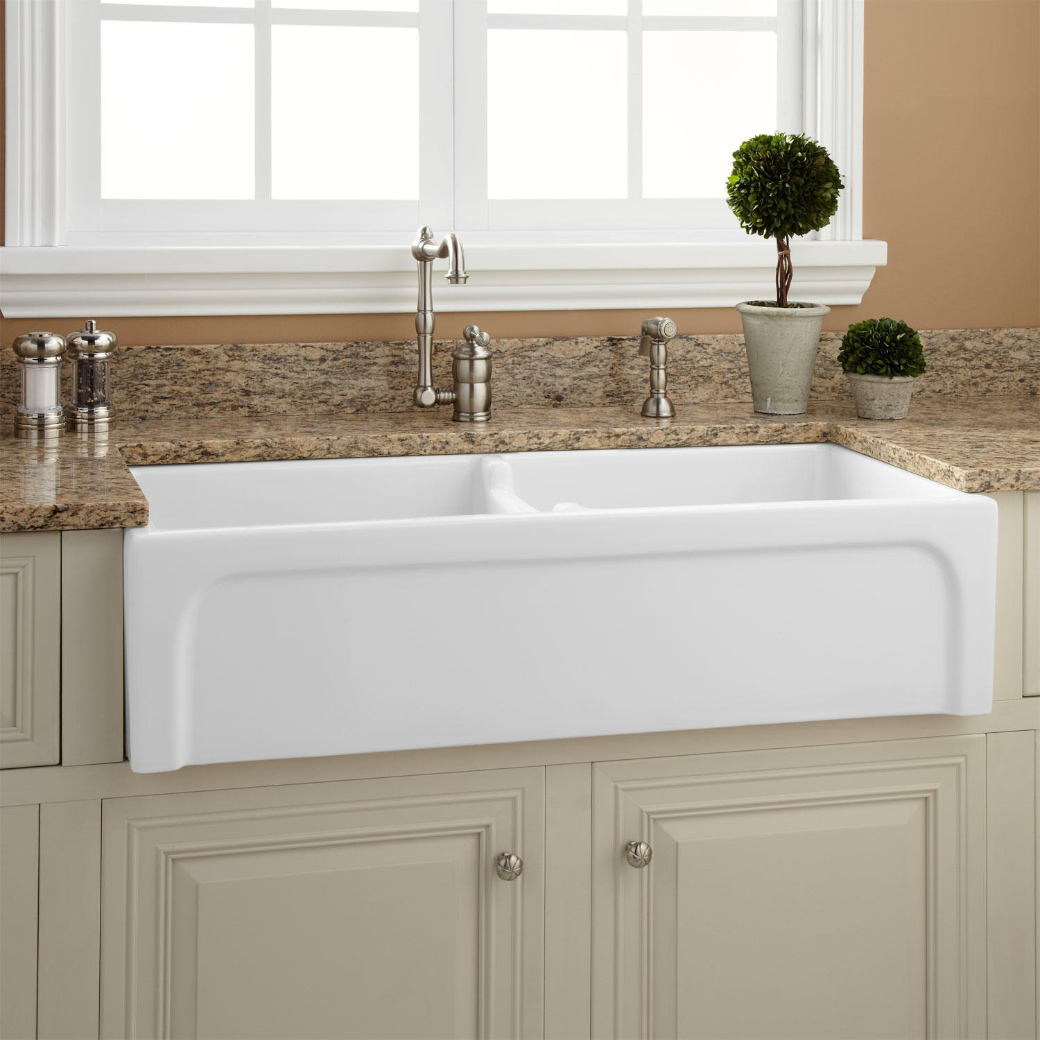 rectangle white apron sink plus silver faucet on white kitchen cabinet with marble countertop under the white window plus white ceramics floor for kitchen decor ideas